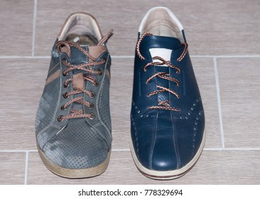 New and old blue shoes on the floor