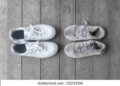 New and old dirty white sneaker shoes on gray wood floor. contrast, comparison, different, new and old, good and bad, clean and dirty, rich and poor concept, fashion shoes background