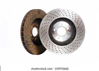 New and old front brake disks for modern car