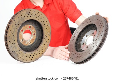 New and old front brake disks for modern car and human hands