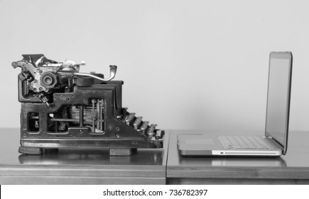 New and old typing machines, black and white photo