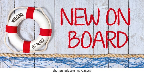 New on Board - Welcome - lifebuoy with text on wooden background