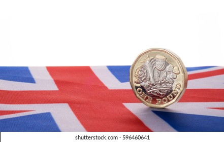 New one pound coin on union jack flag
