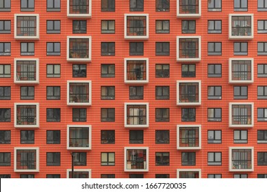 """New orange building facade in housing complex """"Salaryevo Park. PIK"""", Butovo, Moscow city, Russia. Modern style in architecture. House in dormitory area of Moscow. Urban landmark. Symmetry in exterior"""