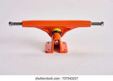 4357860a New Orange Skateboard Parts on a White Background, truck. Skateboard truck  sits on a