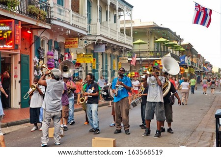 NEW ORLEANS - AUGUST 7: In New Orleans on Bourbon St. on August 7, 2013, a jazz band plays jazz melodies in the street for donations from the tourists and locals passing by on this hot summer evening.