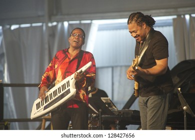 NEW ORLEANS - CIRCA APRIL 2012: Herbie Hancock & West African Guitarist Lionel Loueke Jam at 2012 New Orleans Jazz & Heritage Festival circa April 2012 in New Orleans