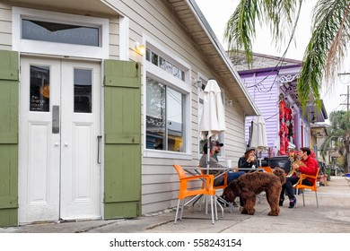NEW ORLEANS - DEC 22, 2016: Coffee drinkers gather at a cafe in the Faubourg Marigny district, considered one of the city's most colorful historic neighborhoods, adjacent to the French Quarter.