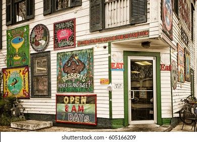 NEW ORLEANS- Dec. 22, 2016: Restaurant in the historic Bywater neighborhood decorated on the outside with colorful funny signs advertising local specialties, cocktails and desserts. Vintage color