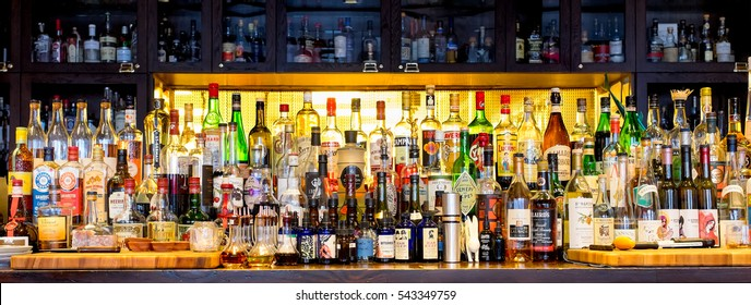 NEW ORLEANS - Dec. 25, 2016: Bottles of alcohol and spirits at a restaurant bar. Large variety of imported and domestic labels, brands and supplies for making cocktails and drinks.