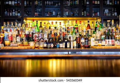NEW ORLEANS - Dec. 25, 2016: Bottles of alcohol and spirits at a restaurant bar. Large variety of imported and domestic labels, brands and supplies for making cocktails and drinks. Copy space.
