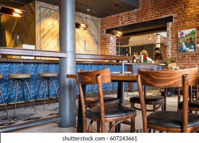 NEW ORLEANS- Dec. 25, 2016: Restaurant interior with exposed vintage brick wall and bar. Mosaic tile floor. Renovated building in the trendy warehouse arts district.