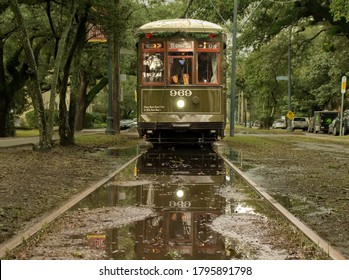 New Orleans - December 28, 2018: New Orleans streetcar reflected in  rain puddle