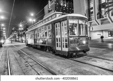 NEW ORLEANS - FEB 11: People travel with the Street car in Canal street at night on February 11, 2016 in New Orleans, USA. It is the oldest continually operating street car line in the world.