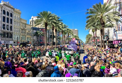 NEW ORLEANS - FEBRUARY 9, 2016: Crowd of tourists and locals along city streets. Mardi Gras is the biggest celebration the city of New Orleans hosts every year.