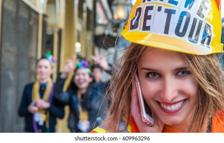 NEW ORLEANS - FEBRUARY 9, 2016: Young girl along city street for carnival parade of Mardi Gras. Mardi Gras is the main carnival eventi in the city.