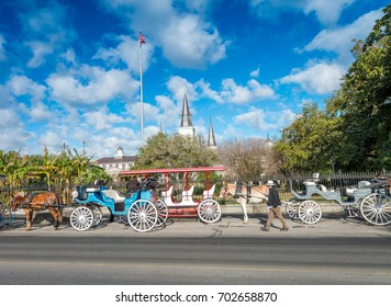 NEW ORLEANS - JANUARY 27, 2016: Tourists in Jackson Square, French Quarter. The city attracts 15 million tourists annually.