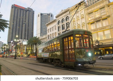 NEW ORLEANS - JUN. 2, 2017: RTA antique Streetcar St. Charles Line Route 12 on Canal Street in morning twilight, New Orleans, Louisiana, USA. This line is registered as a US National Historic Places.