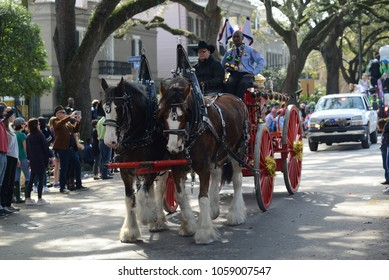 New Orleans, LA - February 9, 2018: The Krewe of Hermes and the Krewe D'Etat showcase their parade down St. Charles Avenue in New Orleans, LA for the Carnival Season.