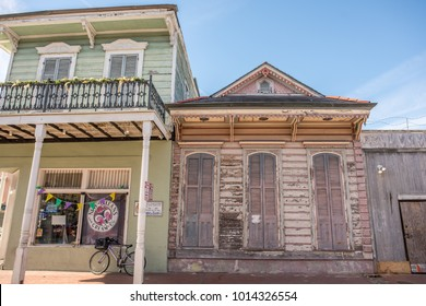 New Orleans, LA, January 25, 2018: A beautiful old home in the French Quarter with typical architecture, including a colorful exterior and wooden shudders for weather protection. Store front next door