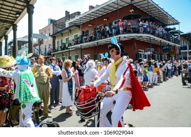 New Orleans, LA / USA - April 1, 2018: The Krewe of Rolling Elvi participates in the Chris Owens Easter parade in New Orleans, LA.