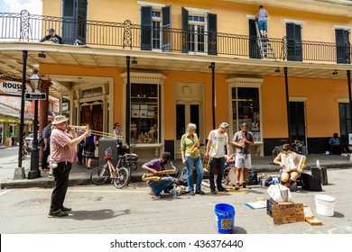 New Orleans, LA USA - April 20, 2016: Street musicians performing jazz music in the historic French Quarter district on Royal Street.