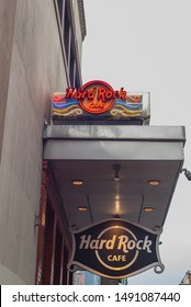 NEW ORLEANS, L.A / USA - AUGUST 19, 2019: Hard Rock Cafe, a Rock 'n' roll-themed chain restaurant, located on Bourbon Street, South Louisiana. A glowing neon sign on the exterior of the building.