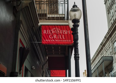 NEW ORLEANS, L.A / USA - AUGUST 19, 2019: Ralph Brennan's Red Fish Grill, casual New Orleans Seafood, exterior restaurant signage.