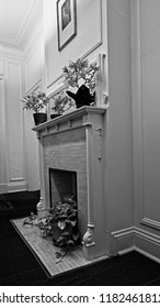 New Orleans, LA USA - May 9, 2018  - Fireplace in Old Building B&W