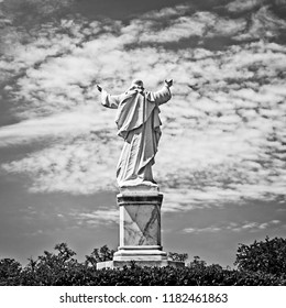 New Orleans, LA USA - May 9, 2018  -  Statue of Jesus with Hands Raised at Loyola University in B&W