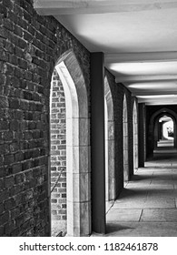 New Orleans, LA USA - May 9, 2018  -  Outside Hallway with Shadows at Loyola University in B&W