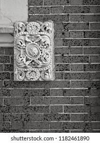 New Orleans, LA USA - May 8, 2018  -  Ornamental Design at a Corner of a Window Tulane University B&W