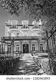 New Orleans, LA USA - May 8, 2018  -  Mansion in New Orleans LA 1 off of St. Charles Ave in B&W