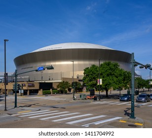 New Orleans, LA, USA -- May 26, 2019.  Wide angle photo of the New Orleans Superdome, the home field of the New Orleans Saints.