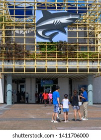 New Orleans, LA, USA -- May 27, 2019.  Some people enter the Audubon Aquarium in New Orleans; others are waiting outside.