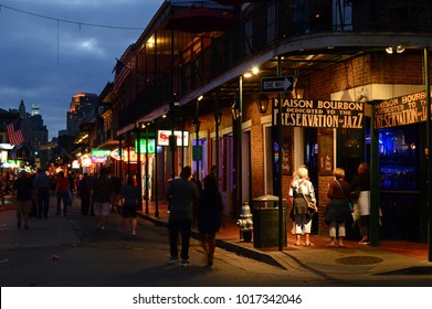 New Orleans, LA, USA October 27 Revelers stroll past Maison Bourbon, a classic New Orleans Jazz club in the French Quarter.