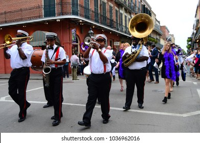 New Orleans, LA, USA October 27, 2015 A group of musicians form a Second Line parade as they march through the French Quarter of New Orleans, Louisiana
