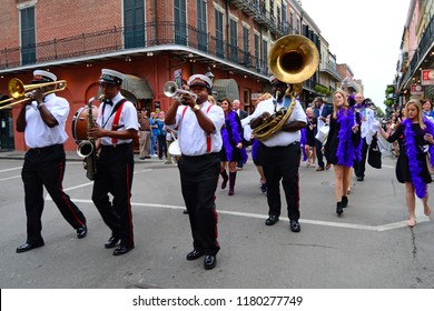 New Orleans, LA, USA October 27 A group of musicians form a Second Line parade as they march through the French Quarter of New Orleans, Louisiana