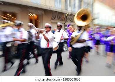 New Orleans, LA, USA October 27,  A zoom shot captures the energy and festivities of a second line marching through the French Quarter of New Orleans