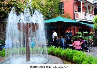 New Orleans, LA, USA October 27, 2015 Folks enjoy a cocktail in a relaxing courtyard at Pat O'Briens in New Orleans
