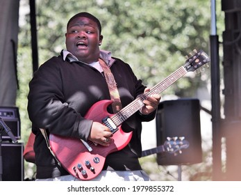 """NEW ORLEANS, LA, USA - OCTOBER 18, 2015: Christone """"Kingfish"""" Ingram plays the blues at the Crescent City Blues and Barbecue Festival (a free festival)"""