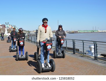 NEW ORLEANS, LA.-JANUARY 18:  Tourists in New Orleans, La., on January 18, 2013, take a segway tour along the Mississippi river front, while awaiting Superbowl XLVII, to be played in the La.Superdome.