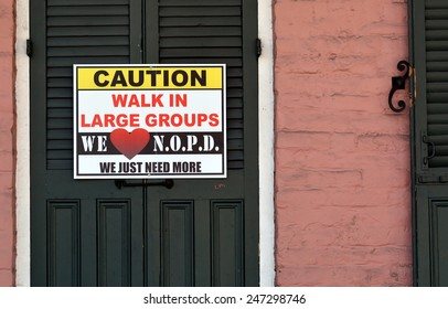 NEW ORLEANS, LA.-JANUARY 24:  A caution sign in the French Quarter warning tourists in town for Mardi Gras to walk in large groups, in New Orleans on January 24, 2015, due to a  recent crime spree.