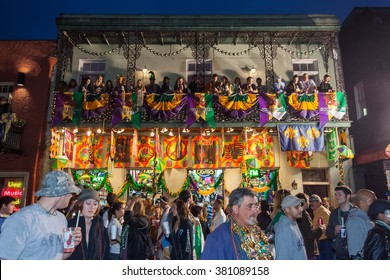New Orleans, LA/USA - circa March 2011: People throwing beads and watching celebration from balconies during Mardi Gras in New Orleans, Louisiana
