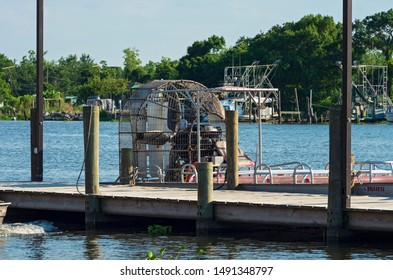 NEW ORLEANS, LA/USA - JUNE 13, 2019: Airboat docked at pier in town of Jean Lafitte. Tourists travel through cypress swamps of the vast Mississippi River Delta region outside New Orleans.