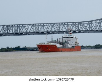 New Orleans, La./USA-May 10, 2019: A liquid petroleum gas tanker on the Mississippi River passes under the Crescent City Connection as it heads toward the Gulf of Mexico.