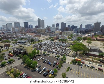 NEW ORLEANS, LOUISIANA - APRIL 11, 2016: St. Louis Cemetery No. 1 in New Orleans and Cityscape with business skyscraper in background