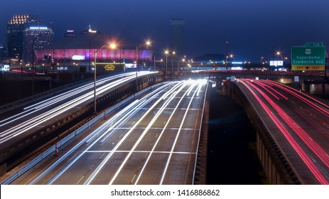 New Orleans, Louisiana - August 1, 2014: Freeway traffic passing Louisiana Superdome