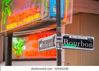 NEW ORLEANS, LOUISIANA - AUGUST 25: Bourbon street sign with Pubs and bars  in the French Quarter, downtown New Orleans on August 25, 2015.
