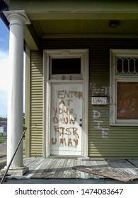 New Orleans, Louisiana - August 27, 2010: Warning to intruders on Hurricane Katrina damaged home